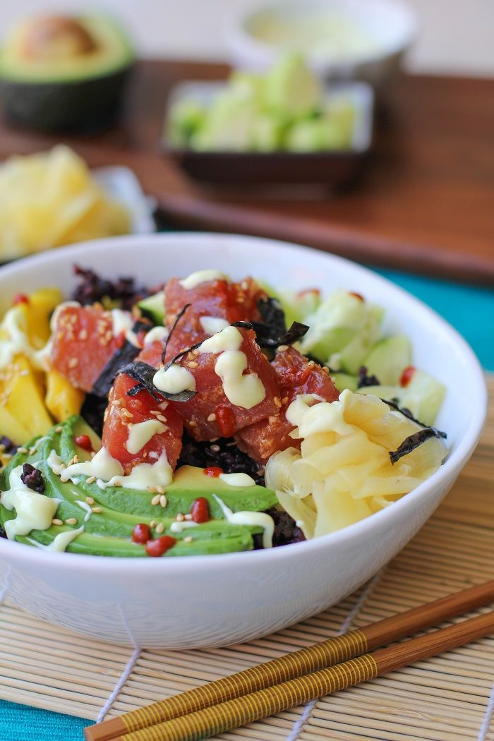 Sushi bowls with forbidden rice, marinated ahi tuna, pickled ginger, avocado, mango, and wasabi mayo are a fun dinner for a sushi night in! A few weeks ago, I showed you my go-to recipe for Ahi Pok…