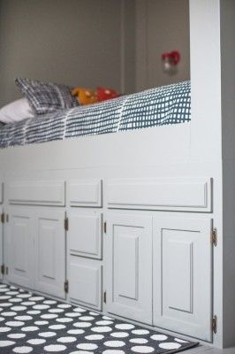 This tour of how an old bathroom vanity was re purposed into a built in bed with underneath storage is an amazing way to frugally create a special place fo