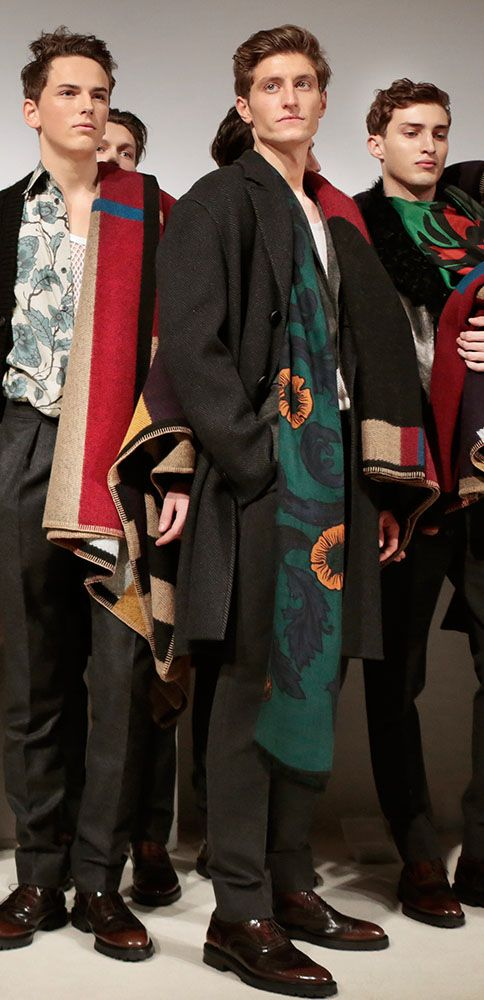 Burberry models backstage after the Prorsum Menswear A/W14 show in London's Kensington Gardens