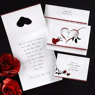 Wedding invitation idea features luminous red roses on a bright white, vertical tri-fold invitation featuring a die-cut heart and red and black foil rose. WR3232-241RE