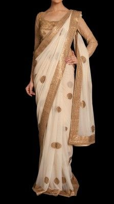 A beige color sari in soft nylon net by Ritu Kumar