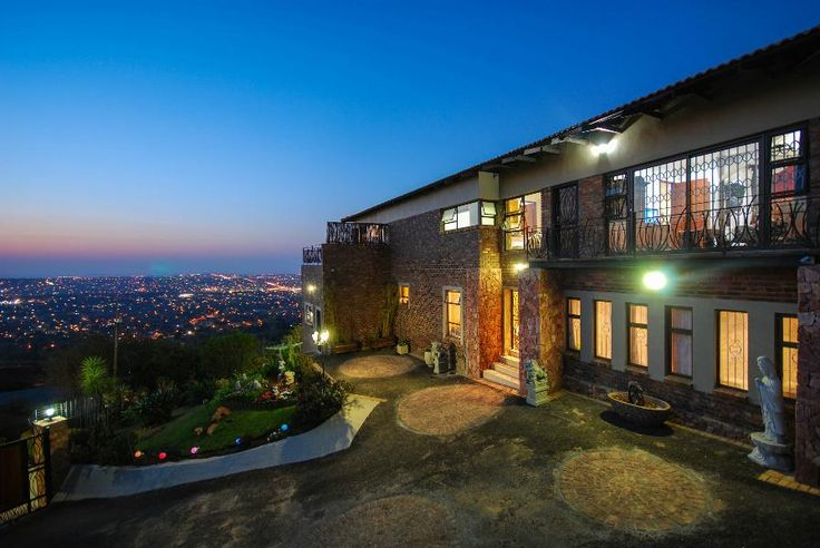 Fusion and Function  African Asian fusion climbs the mountain offering breathtaking 180 degree views, versatile functionality and designer finishes. The central atrium with a zen garden and living room sets the tone of serenity in the home. #northcliff #johannesburg #pamgolding