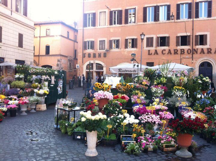"""Campo de' Fiori nel Roma, Lazio Campo dè Fiori means """"field of flowers"""" because the square was originally a meadow but that still rings true today"""