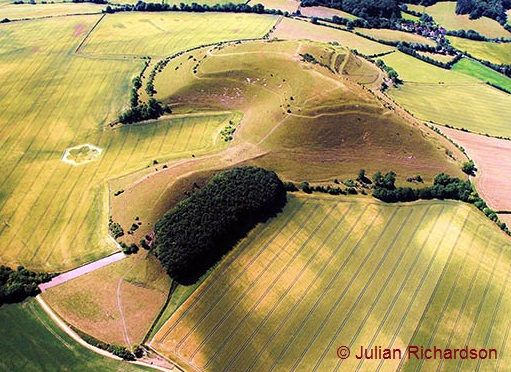 "Cley Hill near Warminster, one of the prominent Wiltshire hills said to have been created by the Devil. The legend goes that the Devil, in anger at the people of Devizes, collected a big hump of soil from Somerset to throw at the town. He enquired directions from an old man who gave him the answer ""that is just what I want to know myself. I started for Devizes when my beard was black, and now it is grey & I haven't got there yet'. In frustration the Devil threw the earth away, forming Cley…"