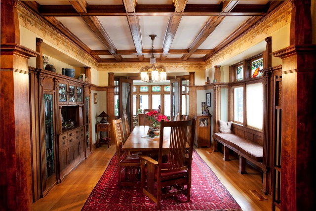 This is a dining room photo of our HCBA members' 100+ year-old arts & craft style home that they have spent 18 years fixing up (it's a process!). It was originally built by a Kraft family member and they still have an old cheese cutting board from the factory in the garage!