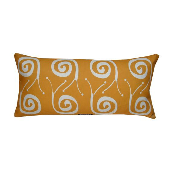 Snail pillow in mandarin - Scandinavian sparse whimsy. Available at: www.etsy.com/shop/troskodesign