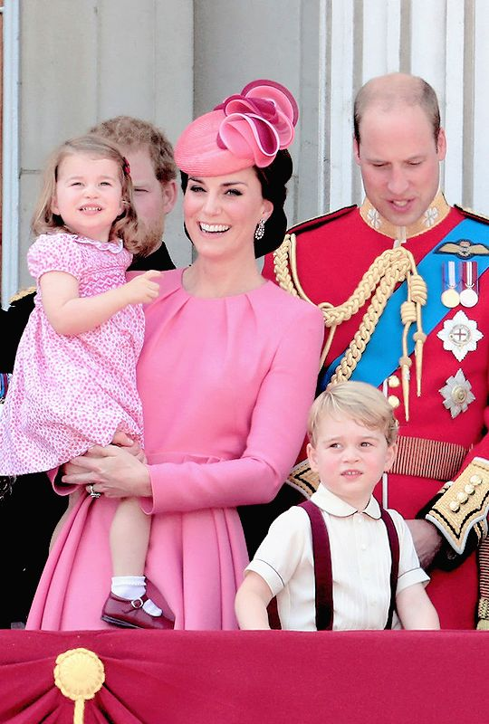 The Cambridge family looking out from the balcony of Buckingham Palace during the Trooping the Colour parade on June 17th, 2017.