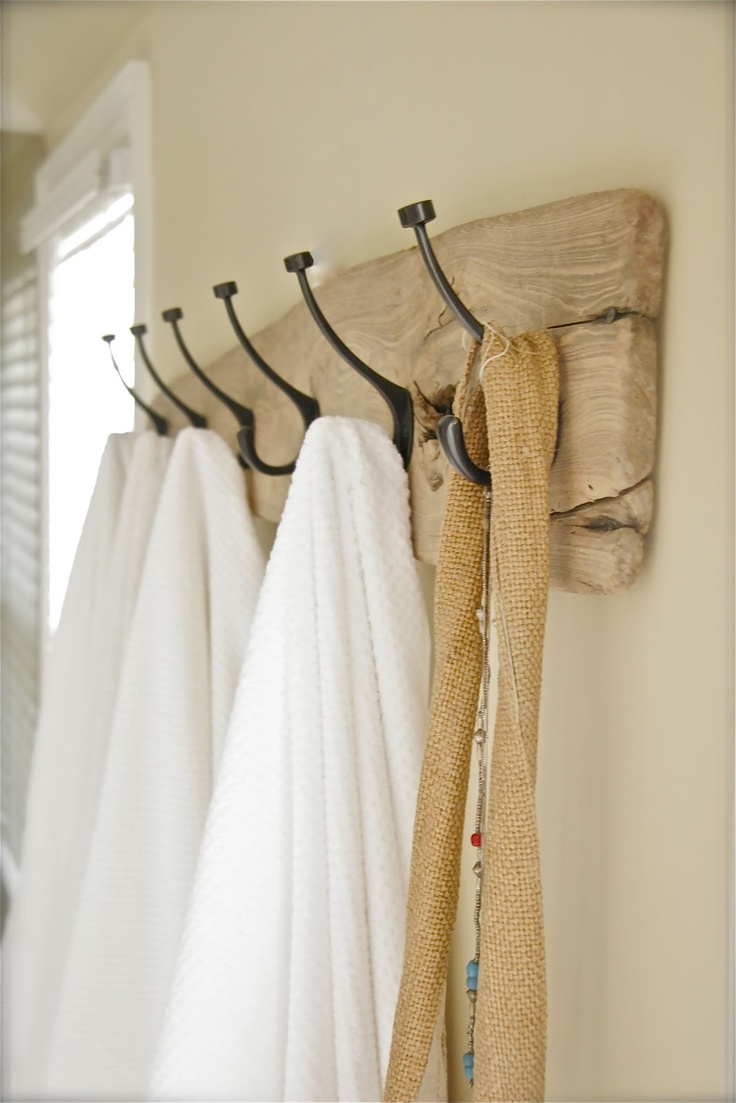 A driftwood hanger offers rustic coastal appeal