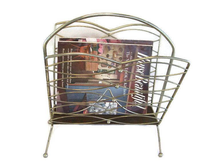 brass midcentury modern magazine rack with graceful curves and 2 vintage magazines. by mudintheUSA on Etsy https://www.etsy.com/listing/475571983/brass-midcentury-modern-magazine-rack