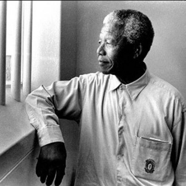 Prisoner 46664 Nelson Mandela revisiting his prison cell on Robben Island. The number 46664 is derived from being prisoner number 466 in the year 1964.
