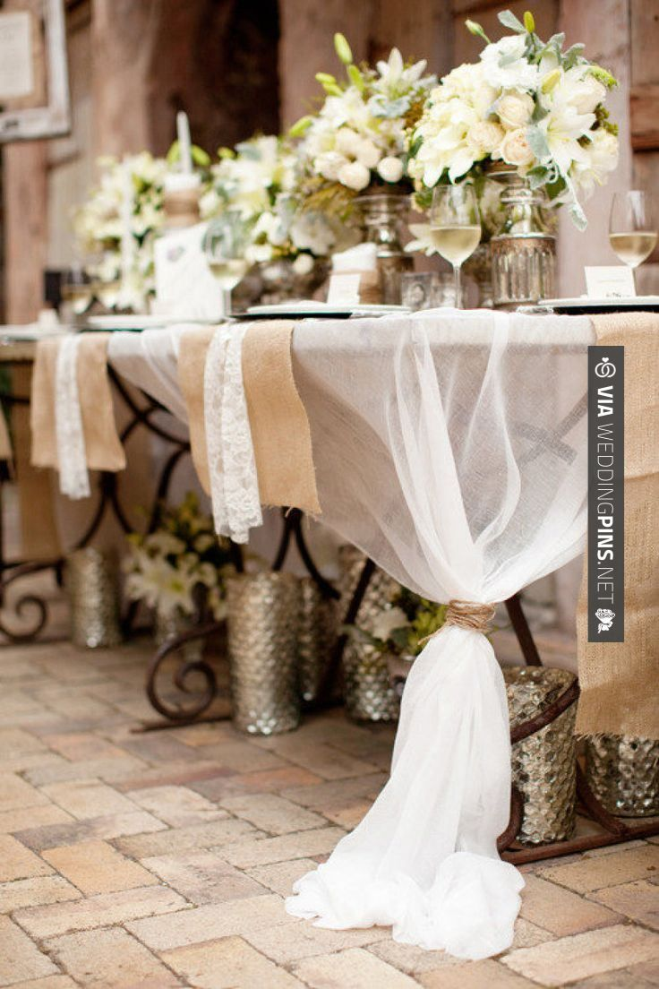 Neat - Sheer fabric tied at opposite corners, with burlap runners and lace napkins.