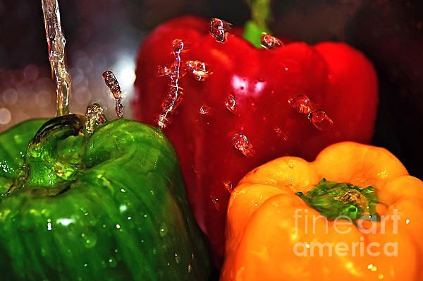 Colorful kitchen art - Bright peppers in the wash. Available available as a poster, framed, canvas prints, metal, acrylic or wood and many useful products with a money-back guarantee. Capsicum in the Wash by Kaye Menner Photography - https://kaye-menner.pixels.com/featured/capsicum-in-the-wash-kaye-menner.html