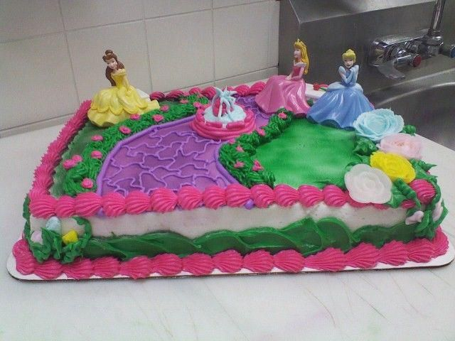 Disney Princess - *  Disney Princess Cake  1/4 sheet marble cake frosted and decorated in buttercream hand piped waterfall, rose bush, and flowers (besides the white one) with toy princess'    www.facebook.com/cakes.sweettooth