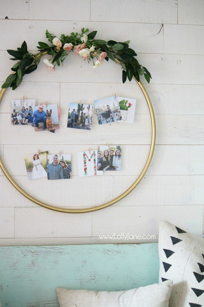 DIY Home Decor: Hula Hoop Photo Display | Check out this easy hula hoop photo display idea! Such a creative way to display pictures with unique items!