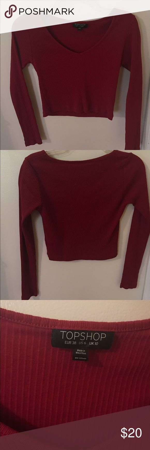 Burgundy long sleeves crop top ! This is a super cute burgundy ribbed long sleeve crop top. It's a size 6 and from Topshop. It's just something that I never really reached for in my closet but it's super super comfortable and true to size. Topshop Tops Crop Tops