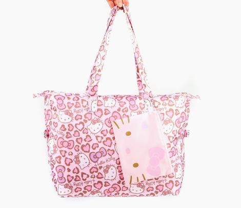 """Hello Kitty Foldaway Bag: Leopard Love  - 14.75""""H x 21.75""""W x 6.25""""D (complies with IATA cabin baggage/hand luggage/carry-on luggage size) - 10"""" drop length - Main compartment is zip-up with side snap fasteners  - Pouch measures: 6.5""""H x 8""""W"""