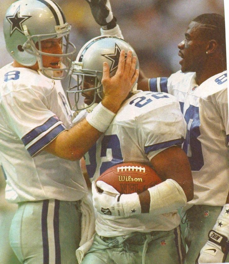 Dallas Cowboys - (pictured) Troy Aikmen, Emmit Smith, Michael Irvin