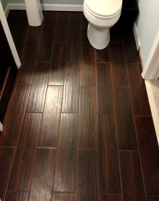 Awesome for bath or kitchen!!!!    Tile that looks like wood. Tile sold at Lowe's. Style Selections 6-in x 24-in Serso Mahogany Glazed Porcelain Floor Tile  Item #: 397694 |  Model #: 1095207