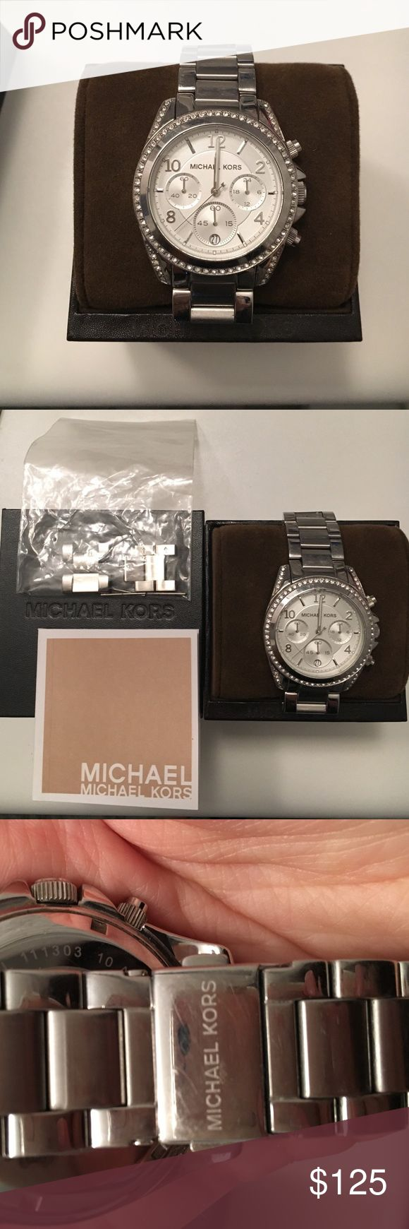 Michael kors silver watch MK5165 Michael kors silver watch. Worn but in great condition.. Few light scratches on back see image. Case diameter 39mm. Comes with original box and extra links! Watch is in need of a new battery. Michael Kors Accessories Watches