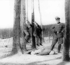 This has been described as Kurt Franz administering pole-hanging punishment, but other sources say it is Martin Sommer at Buchenwald.