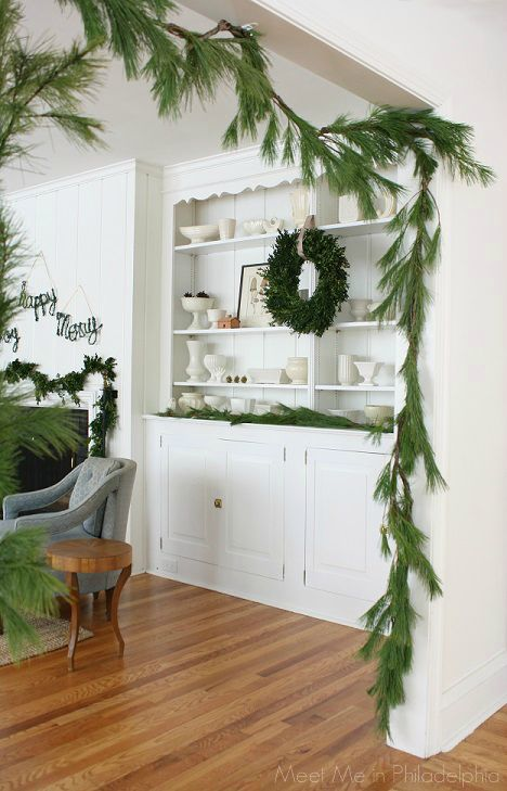 Pine garland around doorway for Christmas (via Meet Me in Philadelphia)