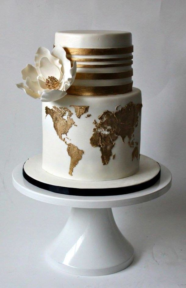 The gold and travel theme is really pretty. 20 Travel Themed Wedding Cakes   SouthBound Bride