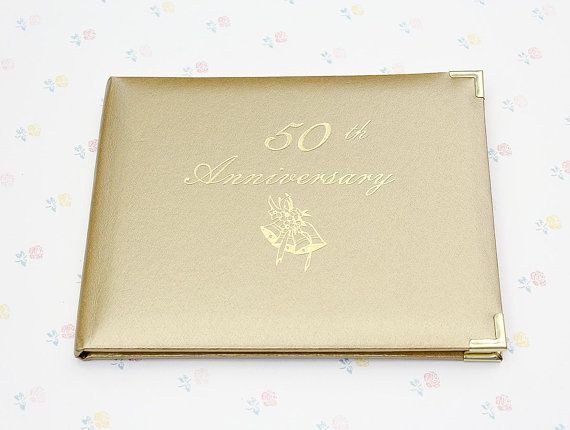 """A beautiful new vintage guest book for a 50th Anniversary celebration. It is in near mint condition. Made in Canada by Hutchings & Patrick Inc. Measures: 6.8""""h x 8.5""""w ***** Browse our collection of Keepsake Gifts & Albums:"""