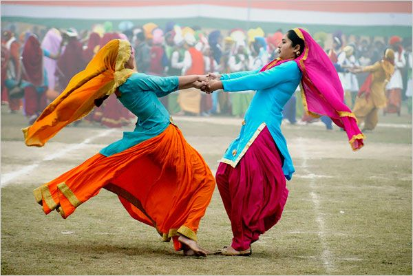 In Amritsar, India, women performed 'Gidha,' a folk dance from the state of Punjab as they took part in India's Republic Day celebrations. India is celebrating its 60th Republic Day, the anniversary of the adoption of the Constitution.  (Photo by Raminder Pal Singh / EPA)