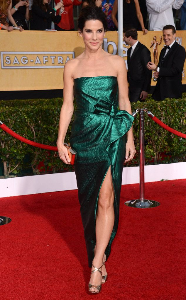 Green with Envy from Sandra Bullock's Best Looks  The Gravity star dazzled at the 2014 SAG Awards in a brilliant emerald green gown by Lanvin. She accessorized with strappy Jimmy Choo sandals and a Roger Vivier clutch.