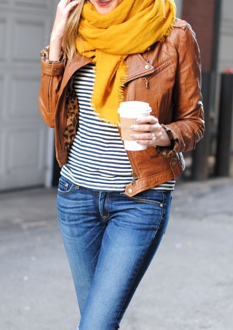 The perfect fall look: a striped tee, jeans, your favorite scarf, and a cognac leather jacket.