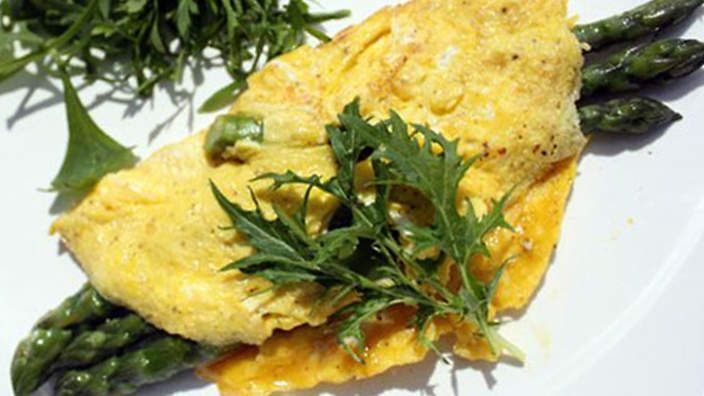 Asparagus omelette | Asparagus goes well with eggs and an omelette is one of the easiest ways to enjoy them together. Follow this recipe for each person you are feeding. Clarified butter is best made by gently melting butter and chilling it in the refrigerator. The unwanted milk solids will settle on the bottom of the bowl, simply pour them away when the butter has set again.