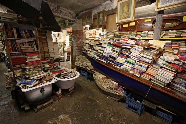 Libreria Acqua Alta in Venice, Italy- the tides get high here, so all the books are in boats or bathtubs to keep them dry