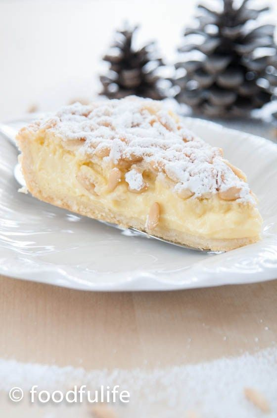 Torta Della Nonna (Grandma's Pie) is a delicious and delicate pie made with a soft shortcrust pastry and filled with plenty of thick Italian custard (Crema Pasticciera) and garnished with lots of pine nuts and icing sugar.