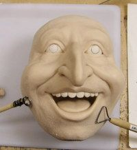 Tutorial for sculpting an open mouthed face.  Photos only.  Click on the russian work under the heart