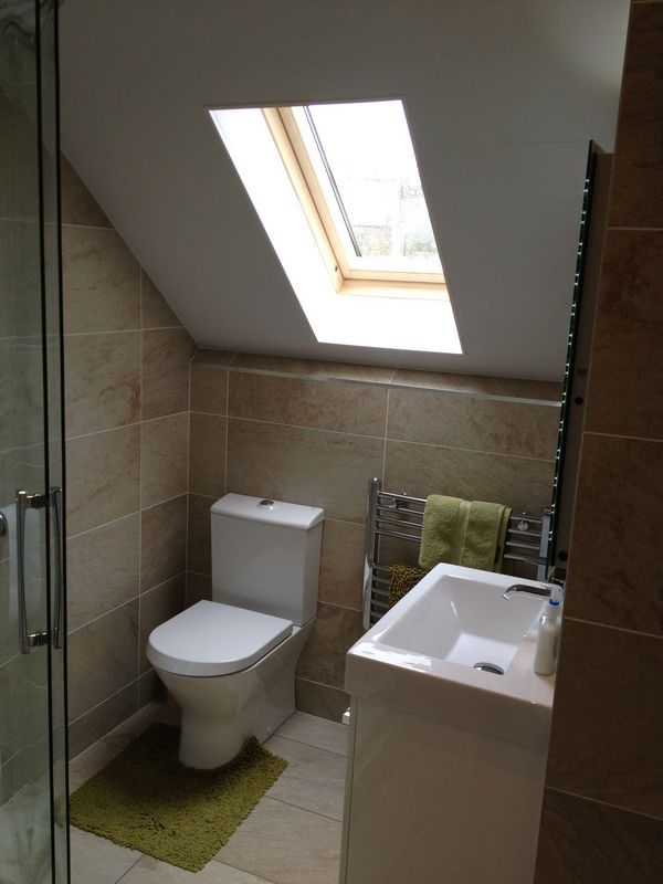 A loft conversion bathroom featuring Roman's Embrace Quadrant. Submitted by Helmanis & Howell, Billingham Tel: 01642 553322, website: www.helmanis.co.uk. Images copyright of Helmanis & Howell, and protected by Roman Ltd. Please do not remove this description & copyright notice.