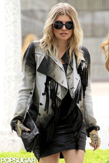 Glamorous: Fergie rocked a leather jacket and gloves as she went shopping with friends in LA Thursday.