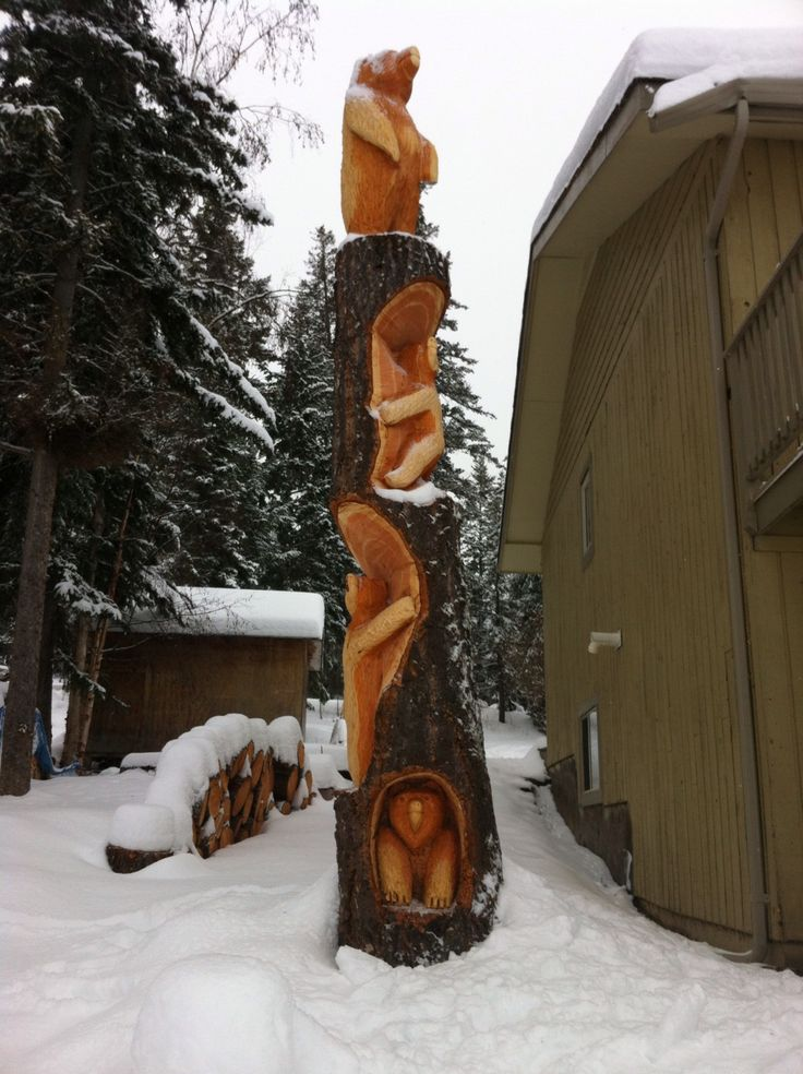 Cut a tree down and then had it carved