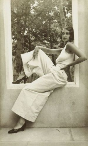 The casual lady enjoys a lazy summer Sunday in the 1930's...wide legged pants and a tank top with a whisper of a Marcel  wave...her only jewelry is a short, chunky beaded necklace...probably glass or bakelite.
