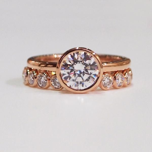 Rose gold bezel set engagement ring with matching wedding band