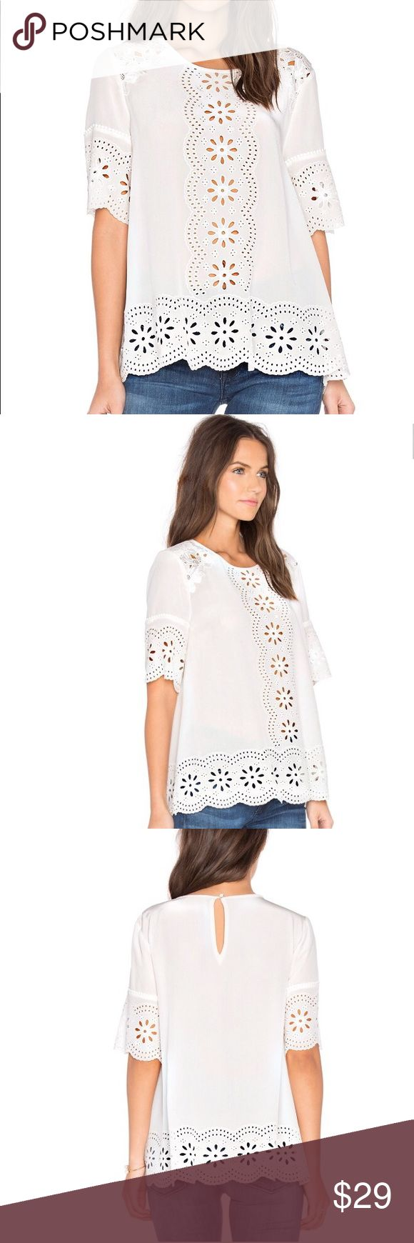 Kate Spade Eyelet & Embroidered Daisy Swing Top Kate Spade Eyelet & Embroidered Daisy Swing Top   Condition: preowned but still in great condition Color: Ivory Size: S kate spade Tops