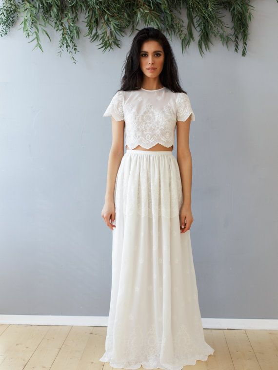 Wedding set of lace crop top and long skirt, boho wedding style. A set of long skirt and cropped top in warm white color. Lace loose top with short sleeves, with buttons on the back. Lush lace skirt with a slim belt, the skirt has lining. Dress is made according to individual measurements of the buyer.  For the manufacture of this dress we will need your measurements: 1) chest waist hips 2) the length of the whole body from head to toe 3) length from waist to desired end of skirt 4) length…