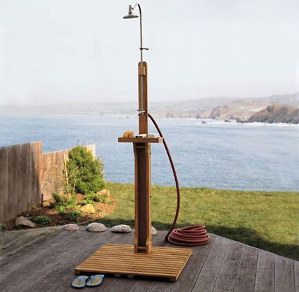 Outdoor showers with garden hoses.  We need this to keep the sand outside this year not inside.