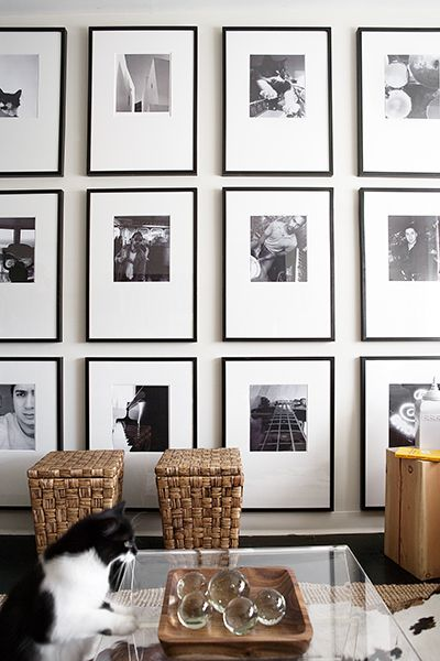 Display wall of black and white photography
