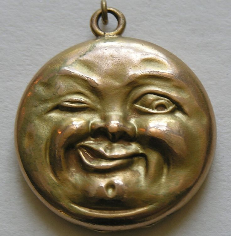 locket features the very poplar Victorian motif of the winking man in the moon