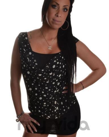 Mini abito donna con fantasia a pois. Vestito elegante, ideale per occasioni formali e per appuntamenti romantici.
