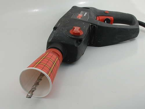 Use a paper cup to catch debris when drilling into the ceiling.  smart