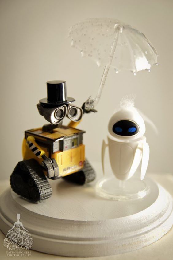 Why settle for a generic cake topper when you can create something truly personal and meaningful to you? Use action figures from toy stores and other creative sources for a one of a kind topper. Wall-E and Eve cake topper. Faith Michele Photography.