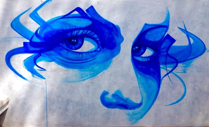 Street mural by Tara Green in the courtyard of Moorish Blue
