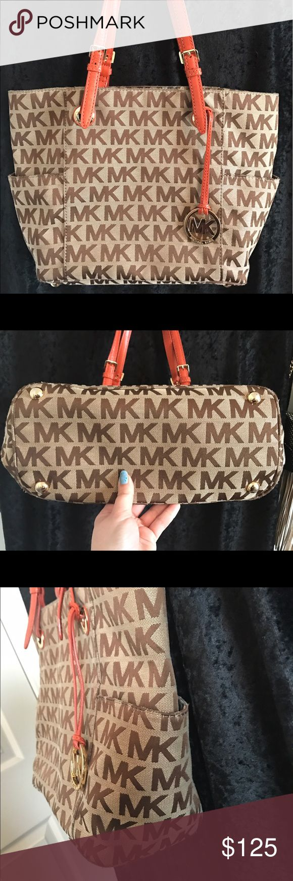 Michael Kors Jet Set Tote Authentic Michael Kors Jet Set Tote in excellent condition! Very nice orange color handles with khaki body. From smoke free home. Michael Kors Bags