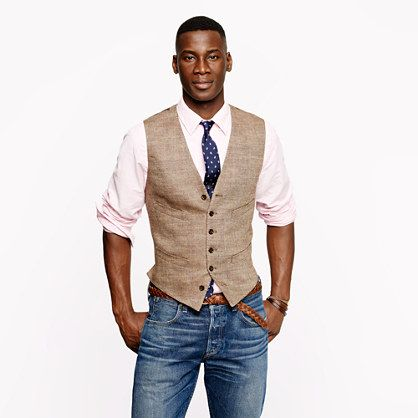 Herringbone vest, button down shirt, jeans. Darker jeans preferred. Maybe try it with a blue, almost chambray shirt?